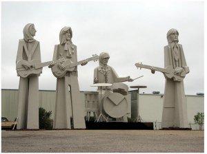 Houston, Texas, USA -- David Adickes' Beatles Statues outside his Sculpturworx studio on Summer Street near Sawyer in West Houston. They stand 36 feet tall