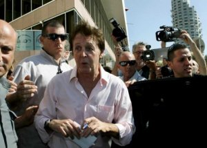 Former Beatle, Sir Paul McCartney surrounded by photographers and security as he leaves a Tel Aviv hotel after a photo call and signs autographs for fans on 24 September 2008. McCartney is due to hold an outdoor concert in a Tel Aviv park tomorrow night with some 40,000 tickets sold. EPA/KOBI GIDEON ISRAEL OUT