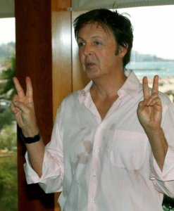 Former Beatle, Sir Paul McCartney gives a double 'V' sign during a photo call in a Tel Aviv hotel on 24 September 2008. McCartney is due to hold an outdoor concert in a Tel Aviv park tomorrow night, amid a Muslim death threat and controversy that when the Beatles were due to perfom more than 40 years ago in Israel they were criticized as a corrupting influence on Israeli youth. Behind is the Mediiterranean Sea and the Tel Aviv promenade. EPA/JIM HOLLANDER