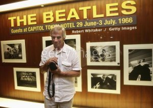 TOKYO - JULY 1: Photographer Robert Whitaker poses in front of his photographic exhibition during the events to mark the 40th anniversary of the Beatles' 1966 visit to Tokyo at the Capitol Tokyu Hotel on July 1, 2006 in Tokyo, Japan. Whitaker was the official photographer for the band's visit to Japan. (Photo by Koichi Kamoshida/Getty Images)