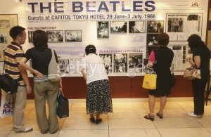 TOKYO - JULY 1: People look at an exhibition during the events to mark the 40th anniversary of the Beatles' 1966 visit to Tokyo at the Capitol Tokyu Hotel on July 1, 2006 in Tokyo, Japan. Whitaker was the official photographer for the band's visit to Japan. (Photo by Koichi Kamoshida/Getty Images)