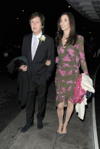 Sir Paul McCartney and wife Nancy Shevell seen leaving Ronnie Wood and Sally Humphreys wedding reception held at the Dorchester Hotel in London.