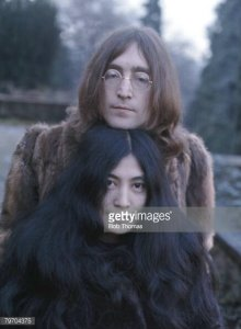 * Yoko Ono and John Lennon at their home in England, December 1968. (Photo by Bob Thomas/Getty Images).