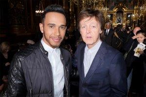 Sir Paul McCartney and Lewis Hamilton attend Stella McCartney show during Paris fashion week