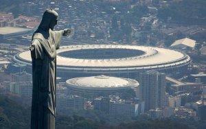 The Christ the Redeemer statue stands above Maracana stadium in Rio de Janeiro, Brazil