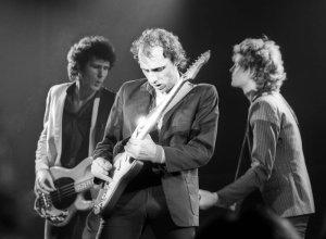 Mark Knopfler,гитара,вокал,автор песен,, Dire Straits