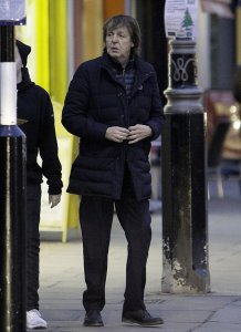 Paul and Nancy blended into the Christmas shoppers perfectly as they left a North London restaurant - Dec 23, 2016