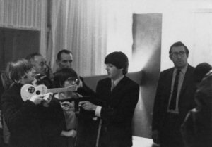* Paul McCartney points a replica machine gun at Ringo Starr while Ringo points a toy Beatle guitar at Paul backstage at the Gaumont Cinema in Southampton, England on Nov. 6, 1964.