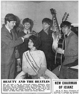 It was quite a day for 15-year-old Cathryn Millington, whose father, Mr. Len Millington, works in Winnington Work Study Department. Chosen Northwich Carnival Queen for 1963, she is here being crowned by Paul McCartney of the 'Beatles' who were the star attraction among the carnival entertainers on Saturday. The other 'Beatles' are Ringo Starr, John Lennon and George Harrison.