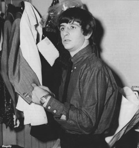 Ringo checking out his costume for the next scene of A Hard Day's Night.