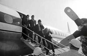 Ringo Starr shields himself from an apple which was thrown from the crowd as The Beatles arrived at the greater Pittsburgh Airport.