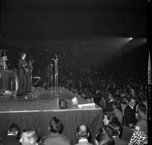 The Beatles perform before a crowd at the Cow Palace in San Francisco on Aug. 31, 1965.