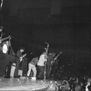 Security guards try to control fans who have rushed the stage at the Beatles' concert at Cow Palace on Aug. 31, 1965.