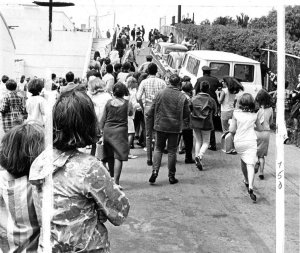The van carrying the Beatles to the Cow Palace as fans rush in on Aug. 31, 1965.