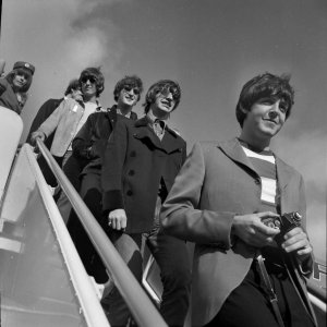 The Beatles arrive in San Francisco on Aug. 29, 1966, for their concert at Candlestick Park. Paul McCartney, Ringo Starr, John Lennon and George Harrison are shown walking down the stairs from an airplane.