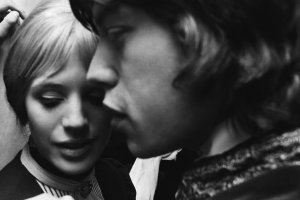 Marianne Faithfull backstage with her boyfriend Mick Jagger after her first night performance as Irina in Chekov's The Three Sisters at the Royal Court theatre in London, 24th April 1967.