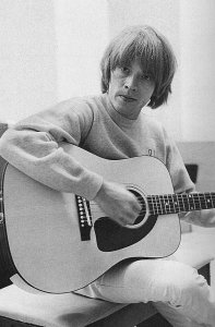 Brian with his new Gibson Heritage acoustic square shoulder jumbo with spruce top and Brazilian rosewood back and sides, given to The Stones by Gibson in May 1965.