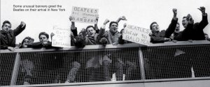 Some unusual banners greet the Beatles on their arrival in New York