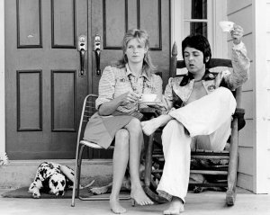 * Paul McCartney, right, and wife, Linda, who've been living the life of country gentlefolks on the Putman farm for the past five weeks, offer a toast to other down home folks. They held a highly informal press conference on the porch with a host of newsmen July 17, 1974.