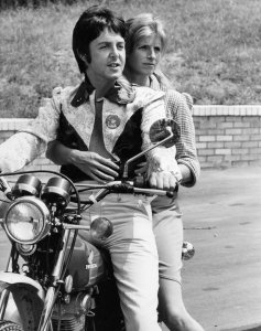* Paul McCartney and wife, Linda, are enjoying the newly purchased motorcycle July 17, 1974. She expressed confidence in her husband's newly acquired cycling skills.