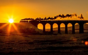 Winter Cumbrian Express travelling over Ribblehead Viaduct by Charlotte Graham