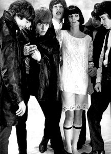 The Rolling Stones pose for a photoshoot with French model Nicole Lamargé for Queen magazine.