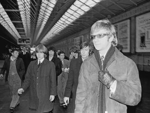 The Rolling Stones and their manager Andrew Loog Oldham arrive at Amiens Street train station in Dublin, 7th January 1965.