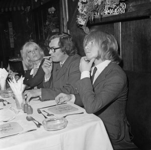 Brian Jones lunches in London during his trial for possession of cannabis, 26th September 1968. With him are his girlfriend Suki Potier and tour manager Tom Keylock . Photo by Trevor Humphries