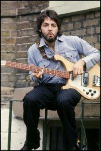 Paul playing bass guitar at home in London. Photo by Linda McCartney #FlashbackFriday