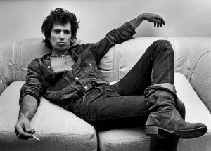 Keith Richards lounges in his office in New York City. Circa 1980. Photo by George Rose