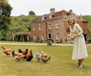 This undated photo supplied by Vogue, shows Madonna feeding the chickens at the English country estate she shares with her husband, Guy Ritchie, and their two children, Lourdes, 7, and Rocco, 4. She's wearing a demure Grace Kelly-inspired chiffon dress and cashmere cardigan designed by Alexander McQueen.