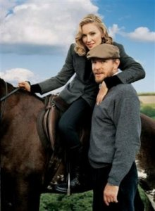 This undated photo supplied by Vogue, shows Madonna on her horse beside husband Guy Richie at the English country estate they shares with their two children, Lourdes, 7, and Rocco, 4. The photo by Tim Walker is part of a spread in Vogue's August issue.