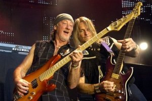 Roger Glover, left, and Steve Morse, right, of the legendary British hard rock group 'Deep Purple' perform on the last day of the 40th Montreux Jazz Festival in Montreux, Switzerland, Saturday, July 15, 2006.