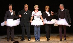 <-- Sir Elton John takes the curtain call alongside original Billy Elliot actor Liam Mower and X Factor judges Simon Cowell, Sharon Osbourne and Louis Walsh following a gala performance of the musical at the Victoria Palace Theatre in London. The show has just sold its millionth ticket.
