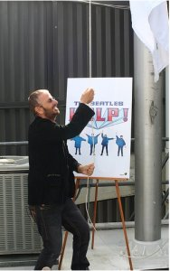 Ringo Starr came to Capitol today for a media event to help promote the release (today) of The Beatles HELP! remastered on DVD. We created an 18-foot by 12-foot flag that will fly above Capitol for 10 days and will the be auctioned off for charity. To bid on the whole package go to
