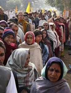Devotees stand in queue to pay homage to the body of Maharishi Mahesh Yogi outside his ashram at Arail, in Allahabad, India, Sunday, Feb. 10, 2008. The body will be cremated at Sangam, the confluence of Rivers Ganges and Yamuna on Feb. 11.