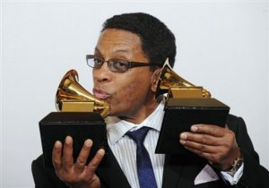 Herbie Hancock poses with the awards for best album of the year and best contemporary jaz album at the 50th Annual Grammy Awards on Sunday, Feb. 10, 2008, in Los Angeles.