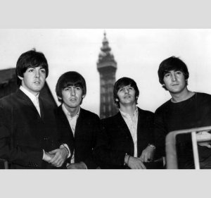 The Beatles with Blackpool Tower behind them