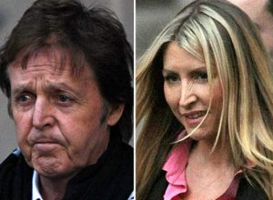 Who's winning? Heather grins after day one in court but Macca looks distraught