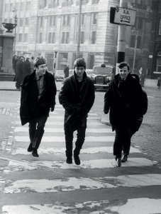 The Beatles in Derby Square at James Street in Liverpool, England on their way to manager Brian Epstein's office on February 19, 1963