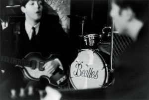 John and Paul during rehearsal for their show at the Cavern on Mathew Street in Liverpool, England on February 19, 1963. Paul is holding his famous viola bass.