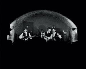 The Beatles performing at the Cavern on February 19, 1963 in Liverpool, England.