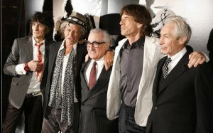Director Martin Scorsese (C) stands with Rolling Stones band members Keith Richards (2nd L), Mick Jagger (2nd R), Ronnie Wood (L), and Charlie Watts as the group arrives at the premiere of the documentary film Shine A Light, directed by Scorsese about the Rolling Stones, in New York March 30, 2008.