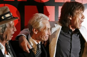 Keith Richards (L), Mick Jagger (R), and Charlie Watts arrive at the premiere of the documentary film Shine A Light, directed by Martin Scorsese about the Rolling Stones, in New York March 30, 2008.