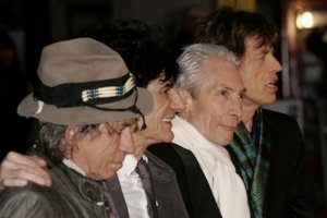 The Rolling Stones, from left, Mick Jagger, Ronnie Wood, Charlie Watts and Keith Richards pose for photographers as they arrive for the UK premiere of the film 'Shine A Light' at the Odeon Leicester Square, London, Wednesday April 2, 2008.