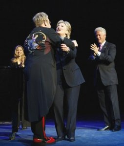 Elton John (L) greets Democratic presidential candidate and U.S. Senator Hillary Clinton (D-NY), and former President Bill Clinton (R) as he takes the stage before performing a fundraising concert for Clinton's campaign at New York's Radio City Music Hall April 9, 2008. Chelsea Clinton watches at rear.
