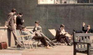In the deckchairs pictured from the left: Management organiser Tommy Quickly, George Harrison, John Lennon and a waving Ringo Starr