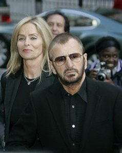 Former Beatle Ringo Starr, escorted by his wife Barbara Bach, arrives to attend the exhibition of photographs by late Linda McCartney, then wife of Paul McCartney, in a central London gallery, Wednesday April 23, 2008.