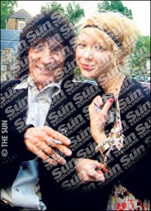 In love ... Ekaterina Ivanova gets cosy with Rolling Stone Ronnie Wood
