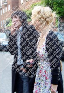 Drag ... alcoholic Ronnie Wood out with Ekaterina, 20 ©2008 NI Syndication